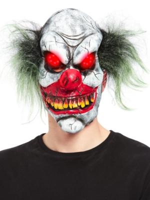 Ļaunā klauna maska ar spīdošām acīm